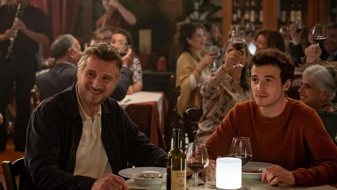 """Micheál Richardson, right, and his father, Liam Neeson, in a scene from """"Made In Italy."""" They play father and son in the film, and their characters are dealing with the loss of their wife and mother. Neeson's wife and Richardson's mother, Natasha Richardson, died over a decade ago in a skiing accident."""