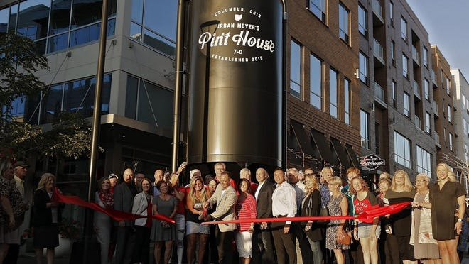 Shelley Meyer and Chris Corso cut a ribbon to open Urban Meyer's Pint House at Bridge Park on Sept. 26, 2019. Next year, Corso plans to open Urban Chophouse in the Short North in partnership with former Ohio State football coach Urban Meyer.