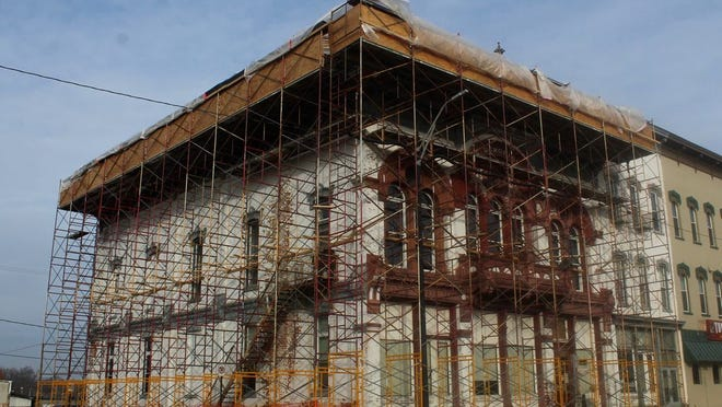 Facade work at the E.L. Clark Memorial Hall at 124 S. Winter St., Adrian, will return the building's exterior to what it would have looked like in 1888, when it was built. Work began in October and is expected to take a couple years.