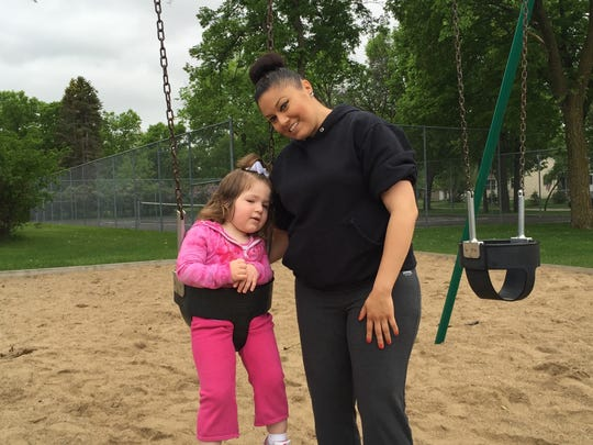 Neighborhood resident Alma Reategoi and her daughter play on the swingset earlier this week at Central Park, located at 2807 Fourth St. N.