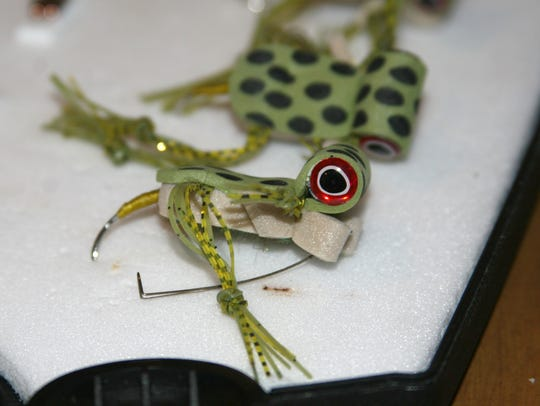 "These CJ's Freaky Frogs are bass ""flies"" made locally"