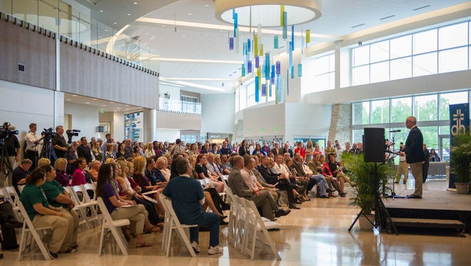 Dr. Dennis Beck, with Orthopeadic Associates, gives a physician's perspective of the new hospital to the crowd during the ribbon-cutting ceremony for the new Deaconess Orthopedic and Neuroscience Hospital on Friday.