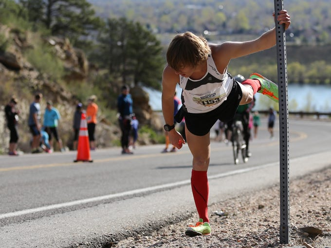 Cory Wagner stretches before running the Horsetooth