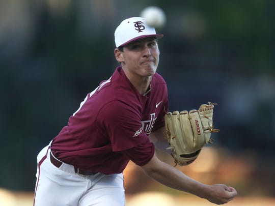 FSU's CJ Van Eyk pitches against Stetson during their game at Dick Howser Stadium on Tuesday.