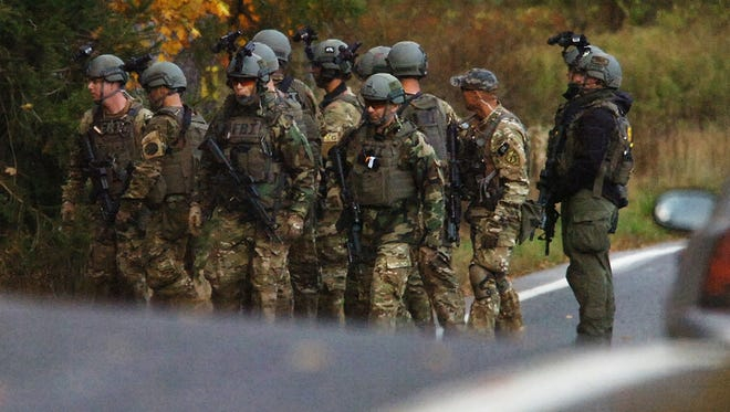 FBI agents prepare to patrol the woods on Lower Swiftwater Road on Oct. 18 during a massive manhunt for Eric Frein in Swiftwater, Pa.