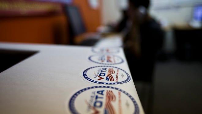 Volunteers from Mi Familia Vota prepare in 2012 to go door to door in south Phoenix encouraging Latinos to vote.