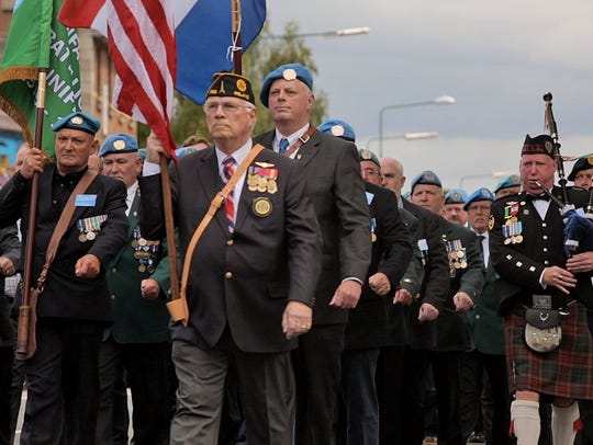 Retired Irish soldiers and others march through the