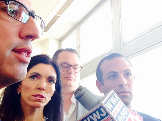 Andrew Abood, left ,and Jeffrey Abood attorneys for Maya Eibschitz-Tsimhoni,  center, speak to the media after both parents appeared before Oakland County Circuit Judge Lisa Gorcyca. Photographed Monday, July 20, 2015.