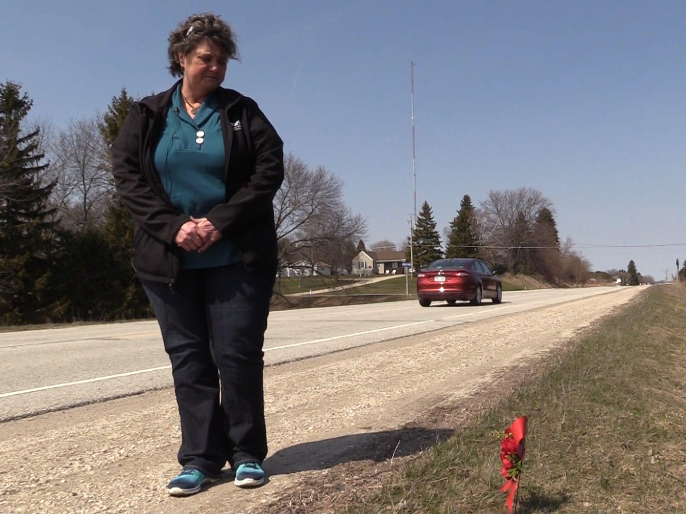 Debi Hochstetler looks over a new memorial wreath that