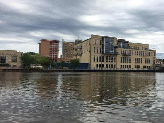Forefront Dermatology is seen across the Manitowoc River.
