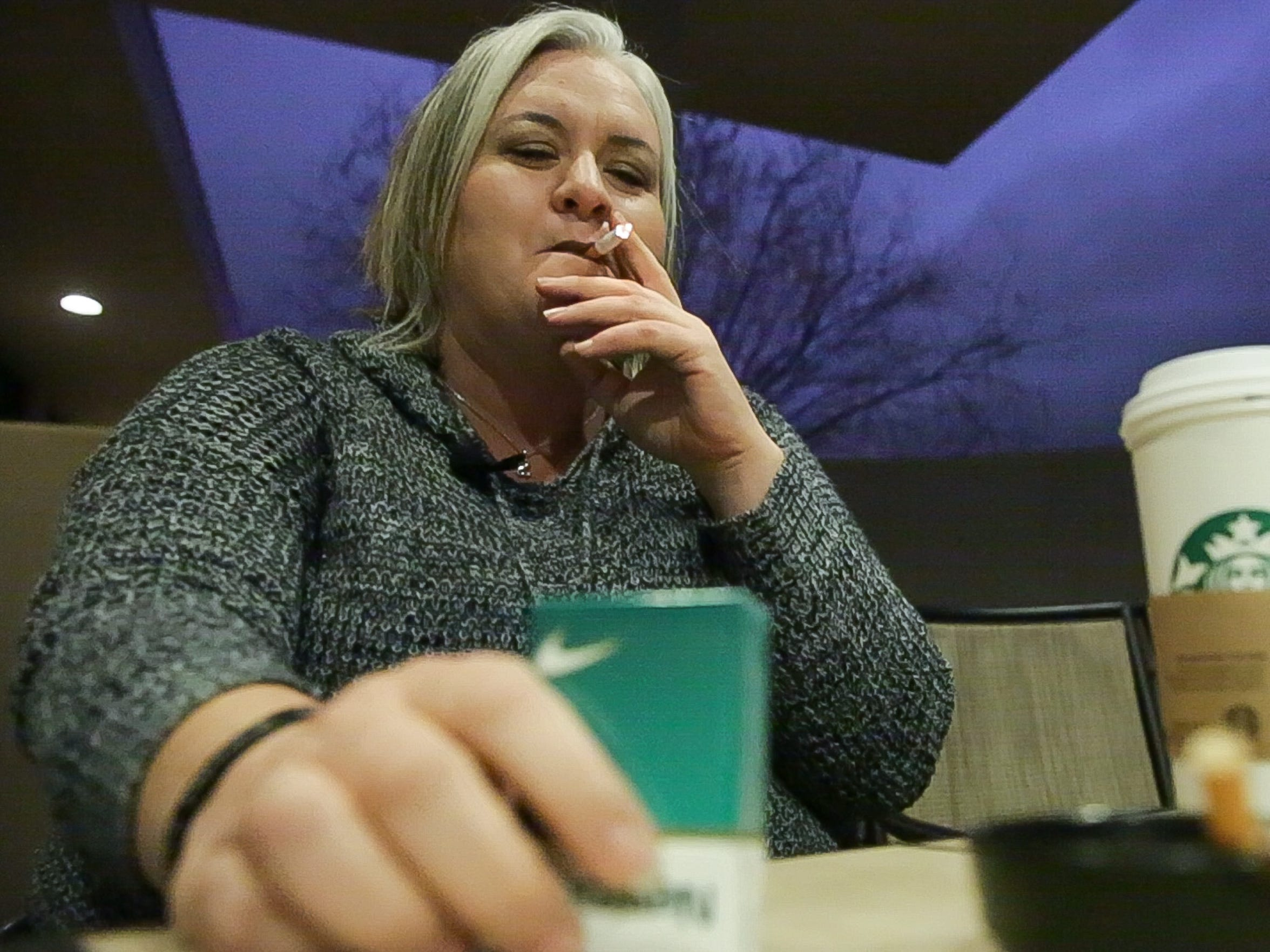 Sarah Stevens smokes her Newport cigarettes on Saturday Jan. 14, 2017. Stevens says she is trying to quit.