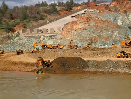 Dredge, construction work continues at Oroville Dam