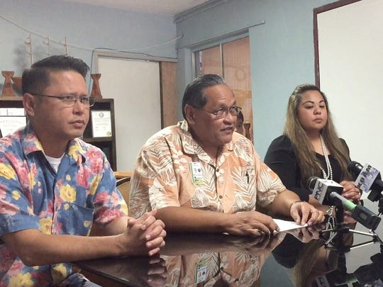 "Lt. Jeff Limo, DOC internal affairs officer in charge, left, Director Alberto ""Tony"" Lamorena, middle, and Deputy Director Kate Baltazar, right, speak about four officers who were issued proposed adverse action notices on May 5, 2017. The notices came after an investigation into a detainee found severely injured in max security."