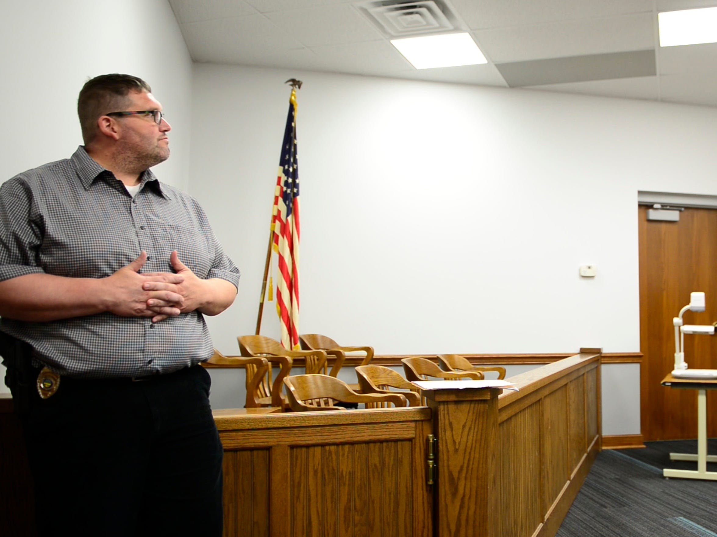 Probation officer Jeremy Greene looks on as Judge John Kolesar holds drug court in Clyde.