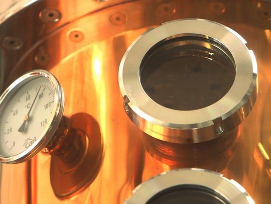 The unique copper still inside the Asbury Park Distilling