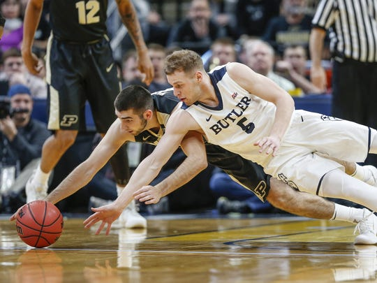 Butler Bulldogs guard Paul Jorgensen (5) and Purdue Boilermakers guard Dakota Mathias (31) fight for a loose ball during the Crossroads Classic at Bankers Life Fieldhouse in Indianapolis on Saturday, Dec. 16, 2017.