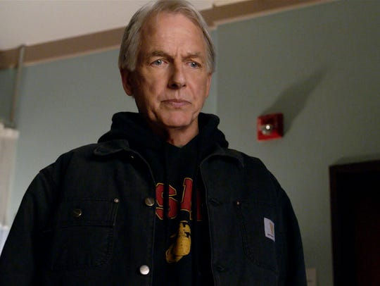 NCIS team leader Jethro Gibbs (Mark Harmon) stands