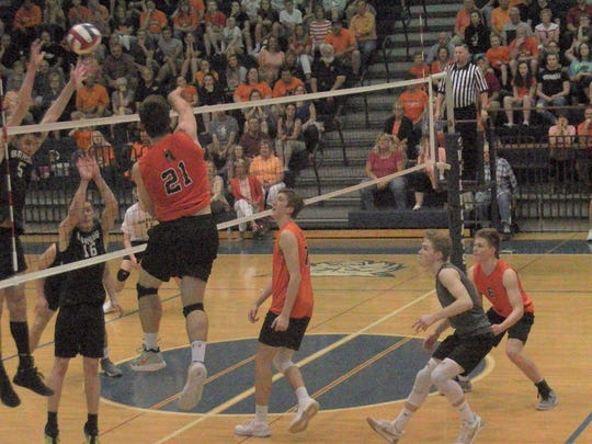Northeastern's Cole Brillhart goes for a kill Friday
