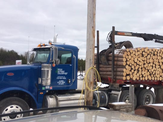 Tom Christ was scheduled to haul this load of pine logs Wednesday morning, a day after he died of gunshot wounds.