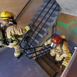 Great Falls Fire/Rescue firefighters Troy Weir, left, and Dave Van Son use a downtown Great Falls parking garage to train for the Scott Firefighter Stairclimb in 2014.