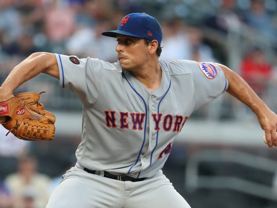 New York Mets starting pitcher Jason Vargas (40) delivers a pitch to an Atlanta Braves batter during the second inning at SunTrust Park.