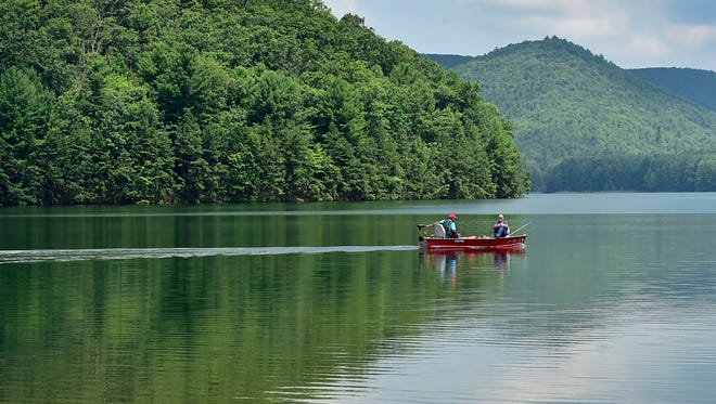 A couple spends the morning of Tuesday, July 18, 2017 fishing at Long Pine Run Reservoir in Michaux State Forest.
