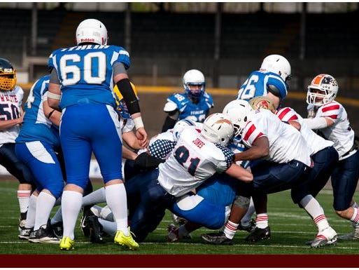 Christopher Jones (No. 81) takes part in an international football game between a team of American high school all-stars and an Italian national team in Rome.