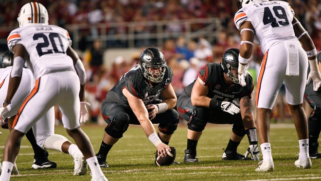 Arkansas center Frank Ragnow gets ready to snap the ball against Auburn in the first half in Fayetteville, Ark., Oct. 21, 2017.