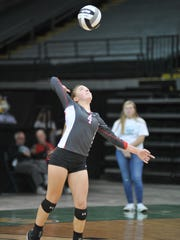 Addie Ackerman serves in game four of the state semifinal.