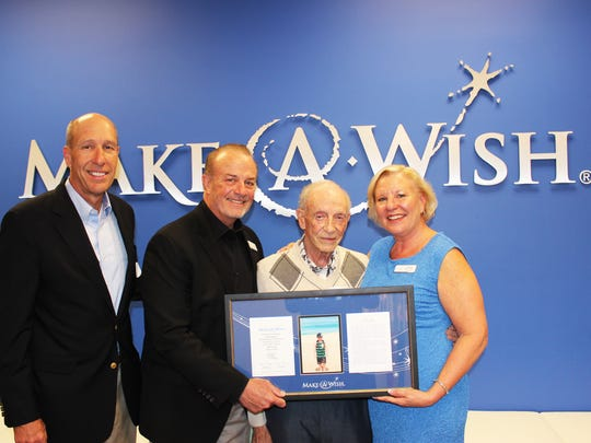 Hartley Gaylord (third from left) is presented with a plaque recognizing his wife's gift from David Williams (left),  president and CEO of Make-A-Wish® America; Michael Hickman, chairman of the board for Make-A-Wish® Orange County and the Inland Empire; and Stephanie McCormick, president and CEO of Make-A-Wish® Orange County and the Inland Empire.