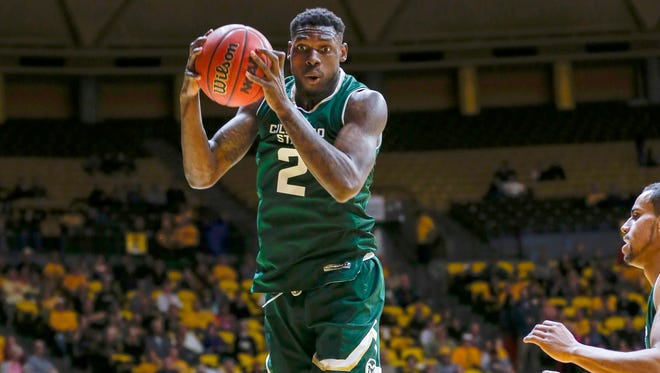 Feb 14, 2017; Laramie, WY, USA; Colorado State Rams forward Emmanuel Omogbo (2) grabs a rebound against the Wyoming Cowboys during the first half at Arena-Auditorium. Mandatory Credit: Troy Babbitt-USA TODAY Sports