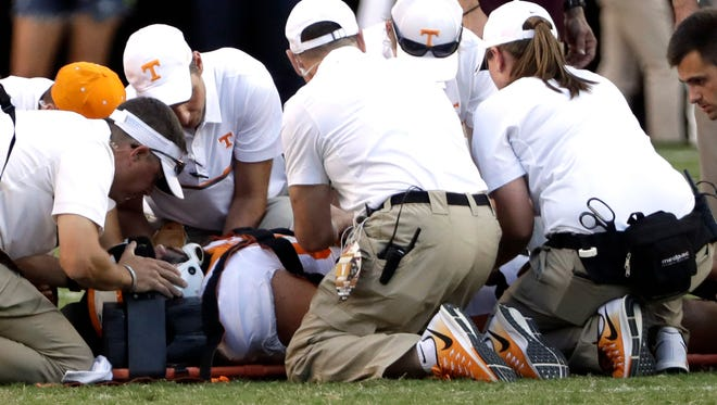 Medical personnel work on Tennessee defensive lineman Danny O'Brien during the second half  against Texas A&M.