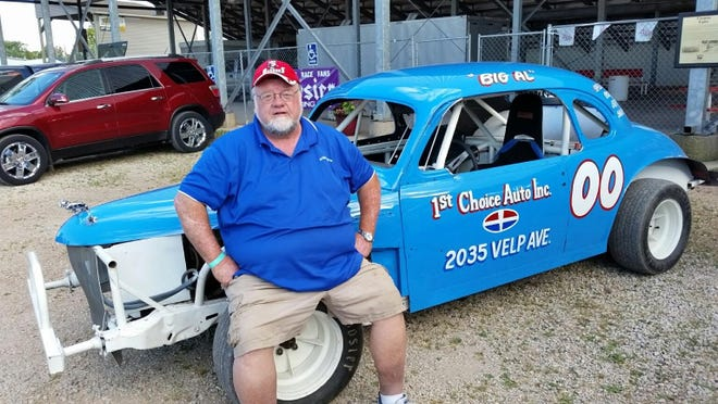 Green Bay's Bob Schampers poses with the coupe replica that was driven by Al Snellenberger at local dirt tracks in the 1960s.