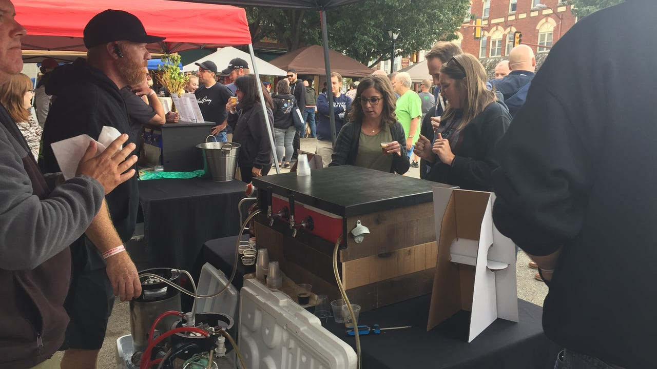 Homebrewers offer tips for creating that perfect beer during Saturday's Homebrew Competition on the square in downtown Hanover.