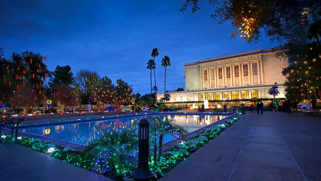People enjoy the Christmas lights on display at the Mesa Arizona Temple of The Church of Jesus Christ of Latter-day Saints Dec 22, 2015  in Mesa.