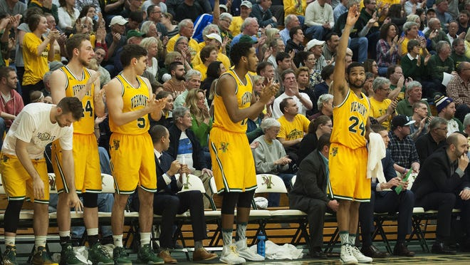 The Vermont bench celebrates during the men's basketball game between Western Carolina and Vermont in the opening round of the College Basketball Invitational at Patrick Gym on Wednesday night.