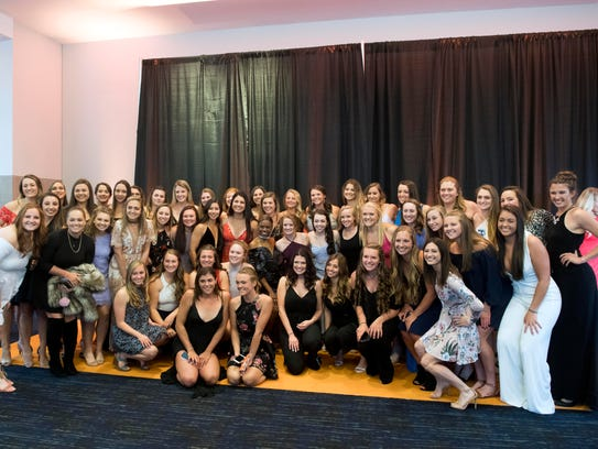 The University of Tennessee rowing team gather for