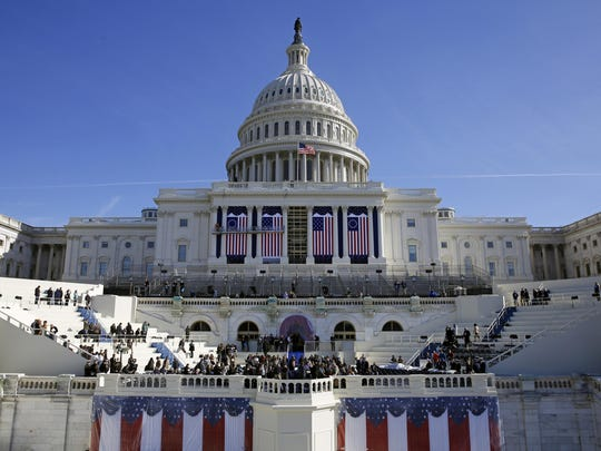 The U.S. Capitol frames the backdrop over the stage Sunday during a rehearsal of President-elect Donald Trump's swearing-in ceremony in Washington.