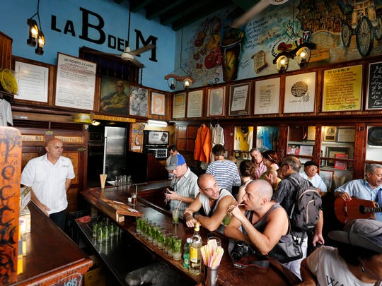 Tourists fill the La Bodeguita del Medio bar where U.S. author Ernest Hemingway used to drink in Old Havana, Cuba.