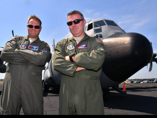 Lt. Col. Brian Schroeder, meteorologist, and Col. Brian May, Commander, 403rd Operations Group out of Keesler AFB in Mississippi standing in front of The WC-130J Hurricane Hunter on display at the 2017 Hurricane Awareness Tour at the Orlando Executive Airport Thursday, May 11th.