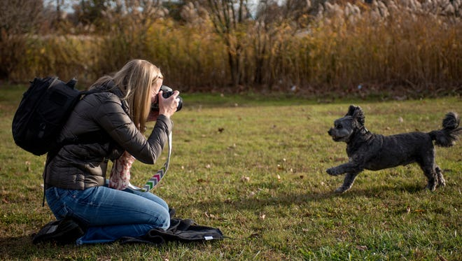 Kim DeGooyer attempts to capture Rocky's best angle at Crestwood Park in Allendale.