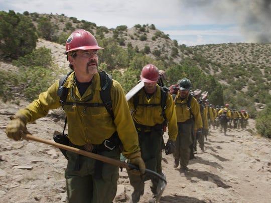 """Supe"" Eric Marsh (Josh Brolin) with his crew in the"