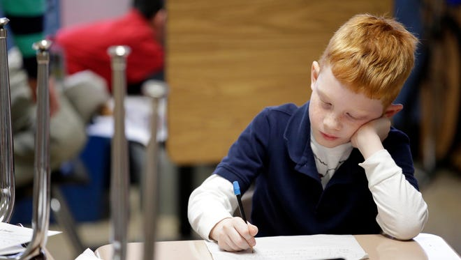 A second-grader studies at an elementary school in Indiana.