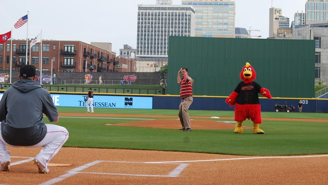 Keith Turner throw ceremonial first pitch at a Nashville Sounds game.