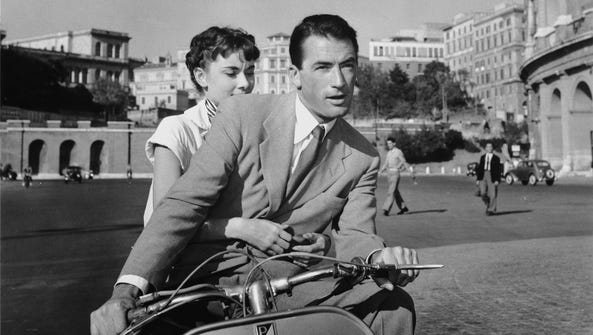 "Audrey Hepburn and Gregory Peck star in ""Roman Holiday,"""