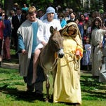A donkey carries a young man representing Jesus during a Palm Sunday service at First United Methodist Church in Montgomery on Sunday.