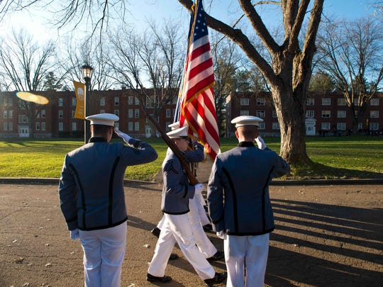 The Norwich University Corps of Cadets marches during Veterans Day observances in Northfield on Tuesday.