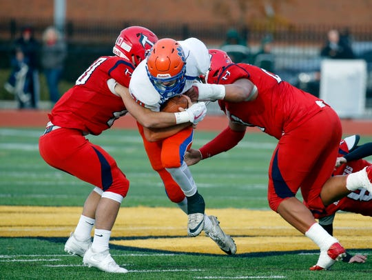 Livonia's Ryan Lambert is tackled by Hornell's Hunter
