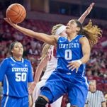 Kentucky guard Jennifer O'Neill drives to the basket during the first half of an NCAA college basketball game Thursday, Feb. 26, 2015, in Fayetteville, Ark. Kentucky won Arkansas 56-51. (AP Photo/Gareth Patterson)