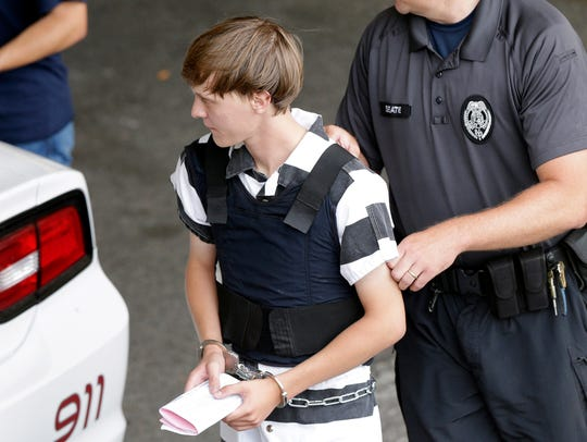 Dylann Roof is escorted from the Cleveland County Courthouse